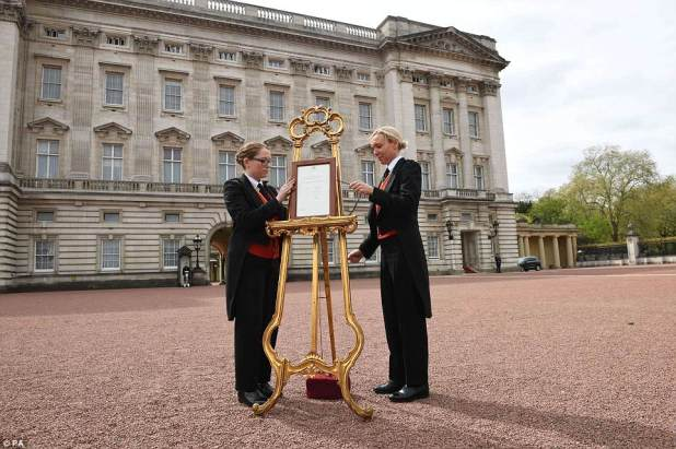 A notice is placed on an easel in the forecourt of Buckingham Palace today to formally announce the birth of the baby boy