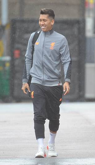 Liverpool's Brazilian striker is all smiles after arriving at Anfield on game day