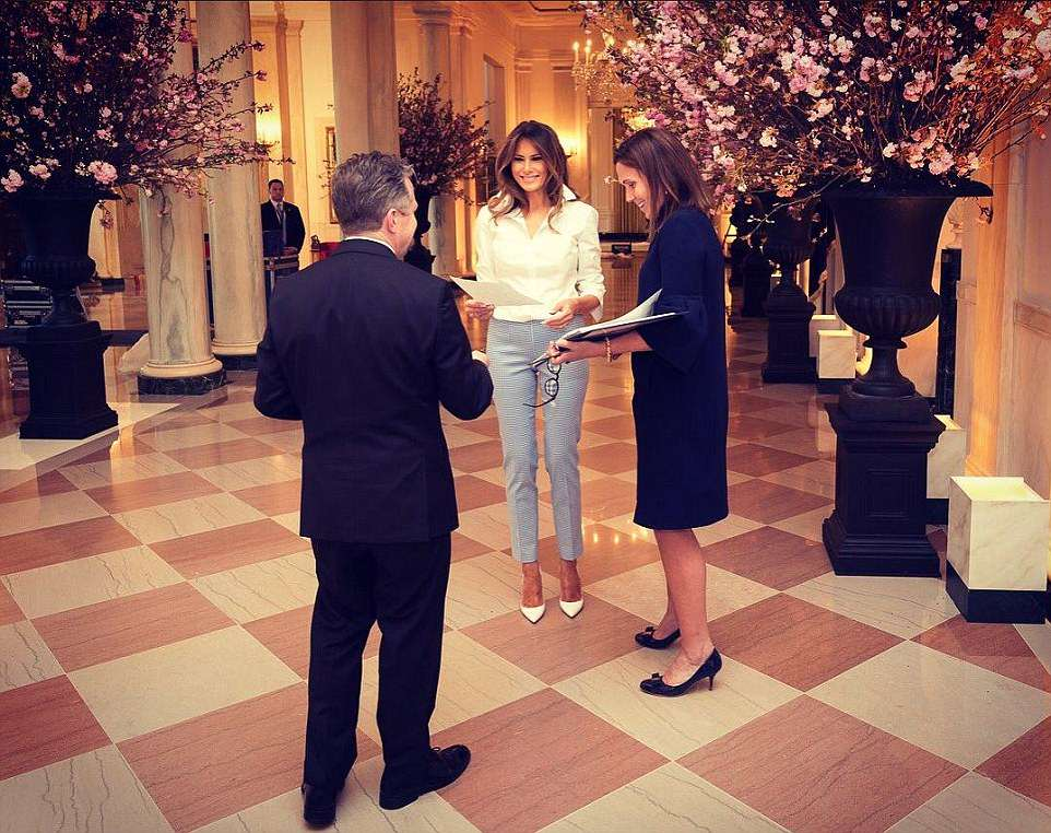 First lady Melania Trump (center) and social secretary Rickie Niceta (right) go over details for Tuesday's state dinner with France