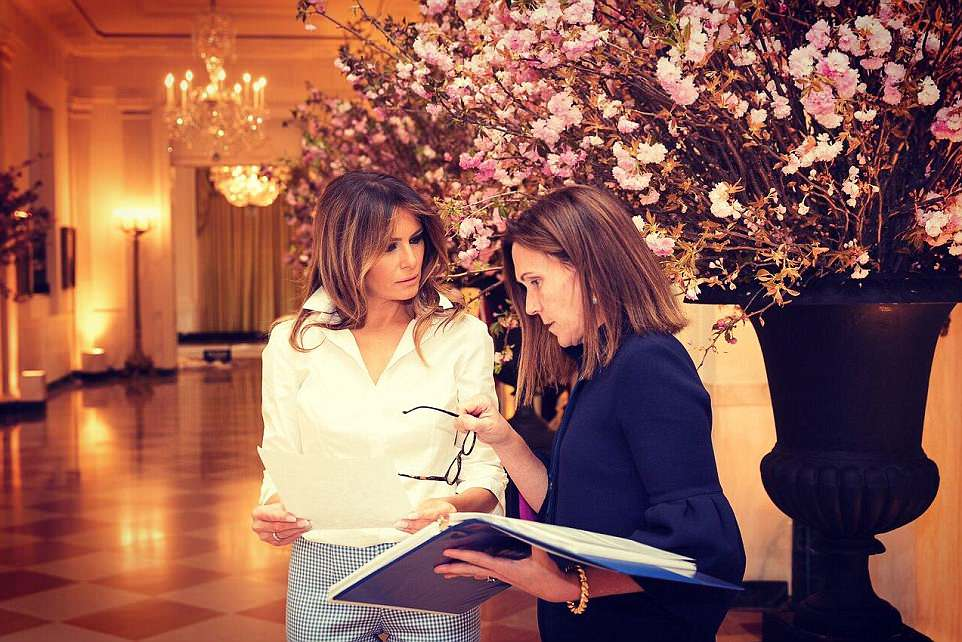 Earlier in the day, the first lady tweeted pictures of herself huddling with her social secretaryRickie Niceta (right) as the two women went over last minute details for Tuesday's state dinner with France