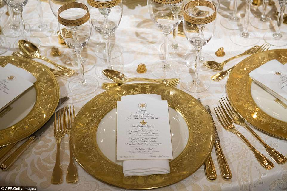 Reporters were briefly allowed into the White House's state dining room Monday night to take in the first lady's designs for the Trump administration's first state dinner