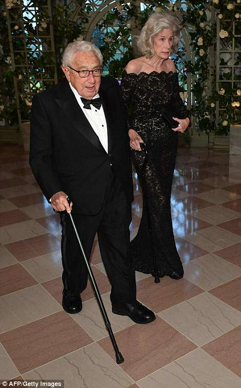 Former US Secretary of State Henry Kissinger and his wife