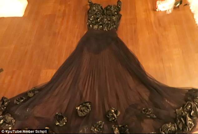 Ta-da: She layered the roses up the skirt a little bit to create 'more dimensions' and glued them on in a zig zag pattern until she finished the entire look at 3:37am