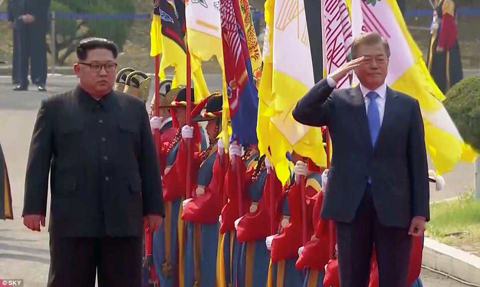 Moon salutes a flamboyant-dressed South Korean welcome guard lined up to greet the North Korean dictator during the unprecedented summit inPanmunjom