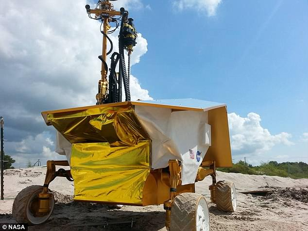 Nasa has cancelled the only robotic vehicle under development to explore the surface of the moon. Pictured is a prototype of the rover, dubbed Resource Prospector, searching for a buried sample tube at the Johnson Space Center rock yard in August 2015