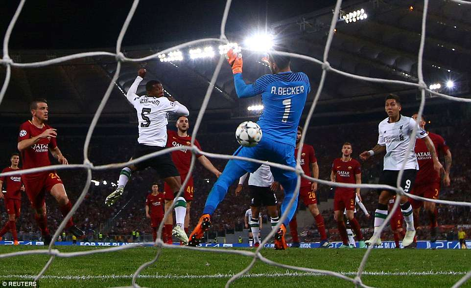 Wijnaldum watches as his header sneaks past Roma goalkeeperAlisson Becker and bounces into the net to make it 2-1