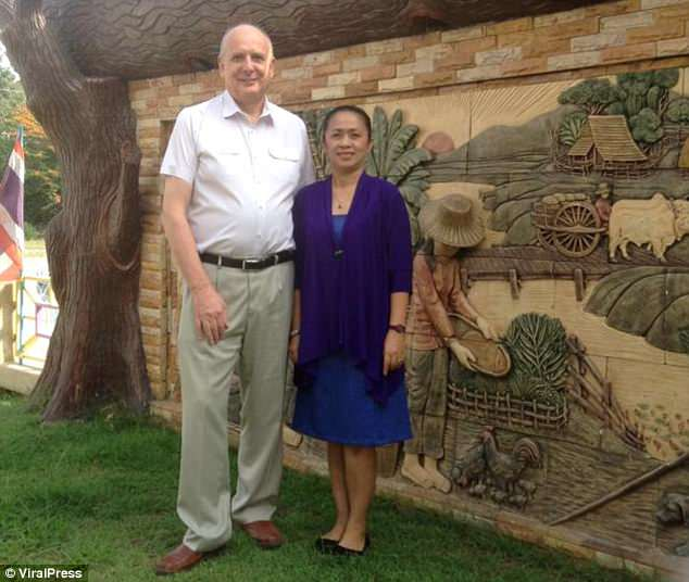 John Toms, 68, with former wife Thanyaporn, 55. He fell 18 floors to his death on Wednesday hours after divorcing her in Pattaya, Thailand