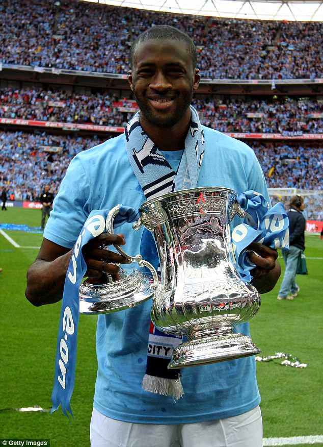 A delighted Toure holds the FA Cup aloft after his winner against Stoke back in May 2011