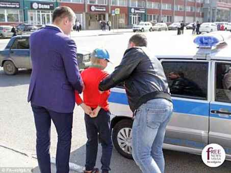 Arrest:Egor Pryanishnikov, 12, was arrested and taken away by police officers in Saratov, southwestern Russia, after making a speech at an anti-Putin demonstration
