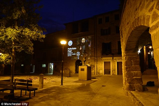 Manchester City boss Pep Guardiola saw his image projected on toSantpedor town hall