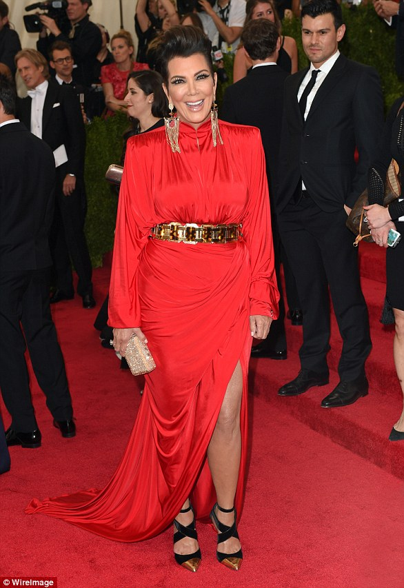 Not so much: Kris Jenner's bold ensemble was widely panned, with the Eighties-inspired shoulder pads and huge waist belt meaning she was lost in the gown