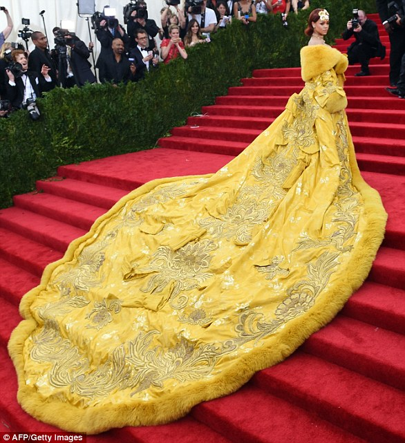 The dress to end all dresses:Rihanna made Met Gala history in 2015 at the exhibition which explored 'the impact of Chinese design on Western fashion' when she tore the famous stairs in the iconic vast yellow coat dress designed by Chinese designer Guo Pei