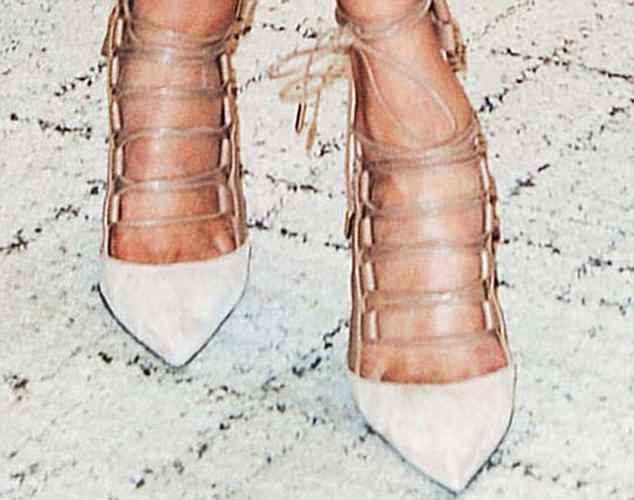 Laced up: Caged Aquazzura nudes were a Toronto favourite for Meghan, worn here at a gallery event she attended in March 2016