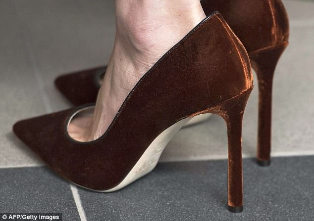 Smooth style: Brown velvet Jimmy Choos while on a surprise visit to Belfast with Harry this March