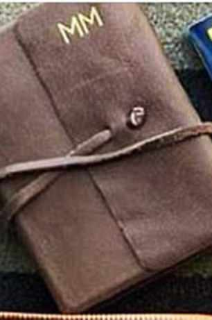 Monogram Meg:With initials like Meghan's, it's no wonder she's into monogramming. Meghan's had 'MM' stamped on items from handbags to phone cases. Her Hunting Season travel bag, left, is embossed with gold initials
