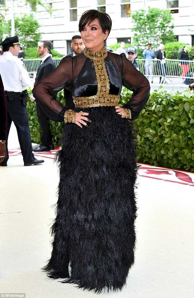 Feather duster comparisons:While Kris Jenner, 62, set Twitter alight with her gothic black dress, with fans comparing the look to a feather duster as they joked she was 'cleaning up the mess Kanye West made on social media' following his bizarre tirade