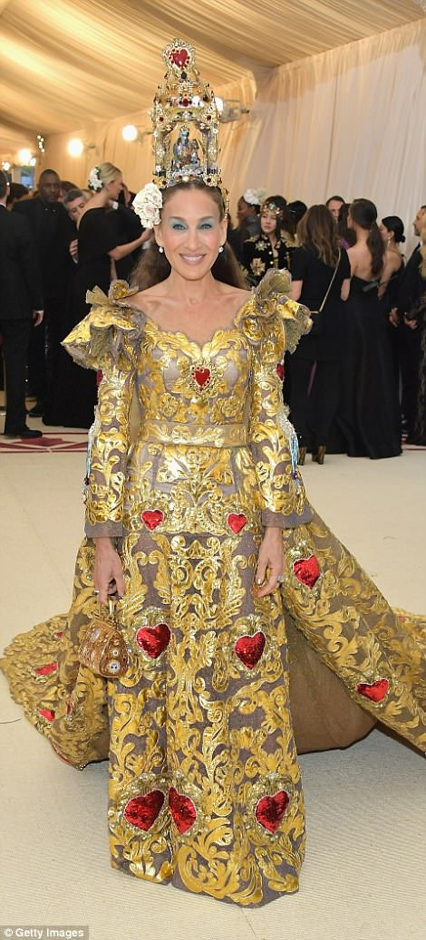 Goddess: Sarah Jessica Parker wowed in her gold and copper look, which included large red hearts all over; she is wearing a Dolce And Gabbana gown