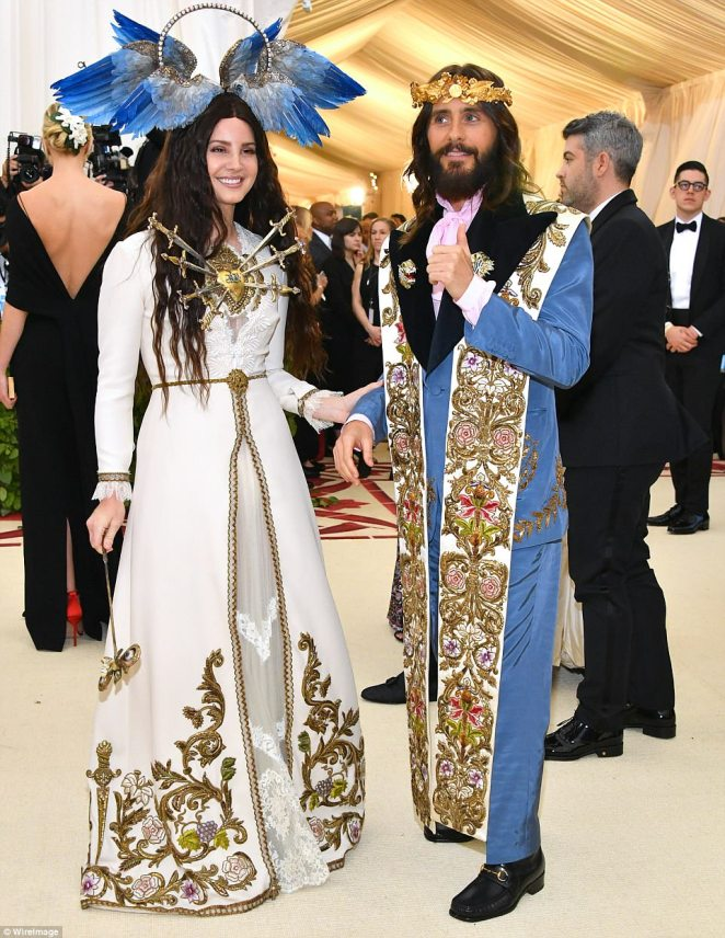Lana Del Rey and Jared Leto both sported Gucci on the carpet Monday. Leto appeared to have blended an assortment of Christian attire for his outfit