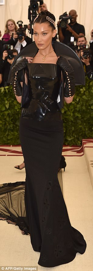 Bella Hadid went for the black leather and PVC look, complemented by crosses