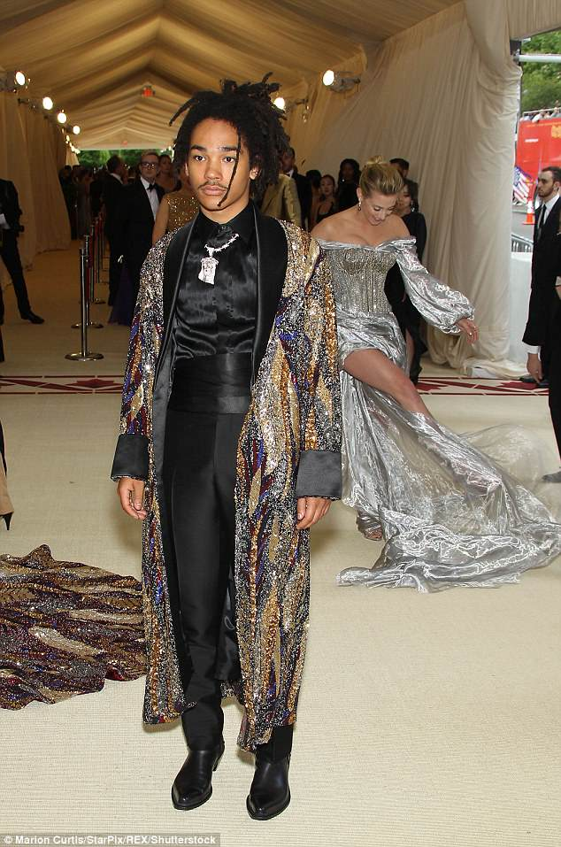 Actress Lili Reinhart appeared to be having trouble with her dress as she got in the way of Jayden Smith's photograph