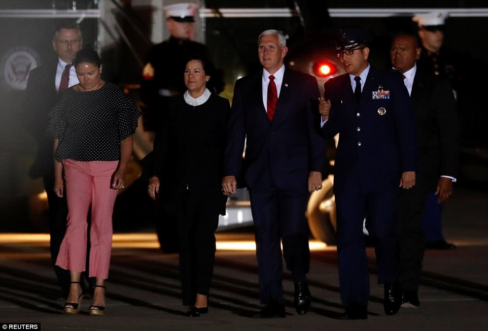 Vice President Mike Pence and second lady Karen Pence (together at center) arrive to greet the three Americans formerly held hostage in North Korea