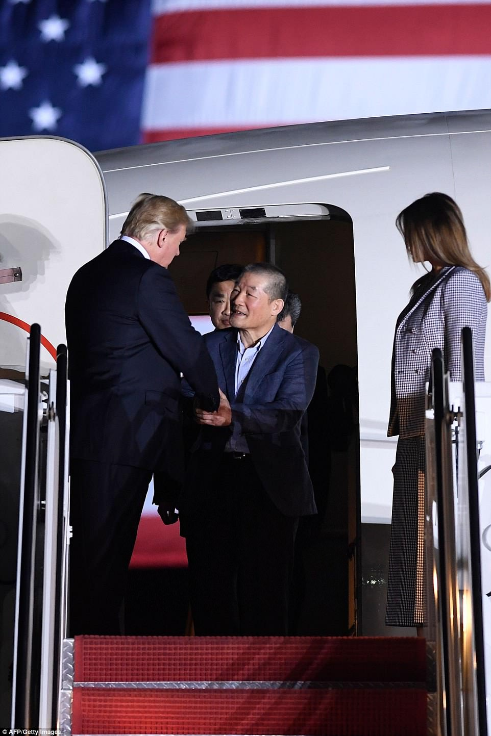 Trump shook hands with former detainee Kim Dong-chul (center) upon his return with Kim Hak-song and Tony Kim (both behind) in extraordinary scenes