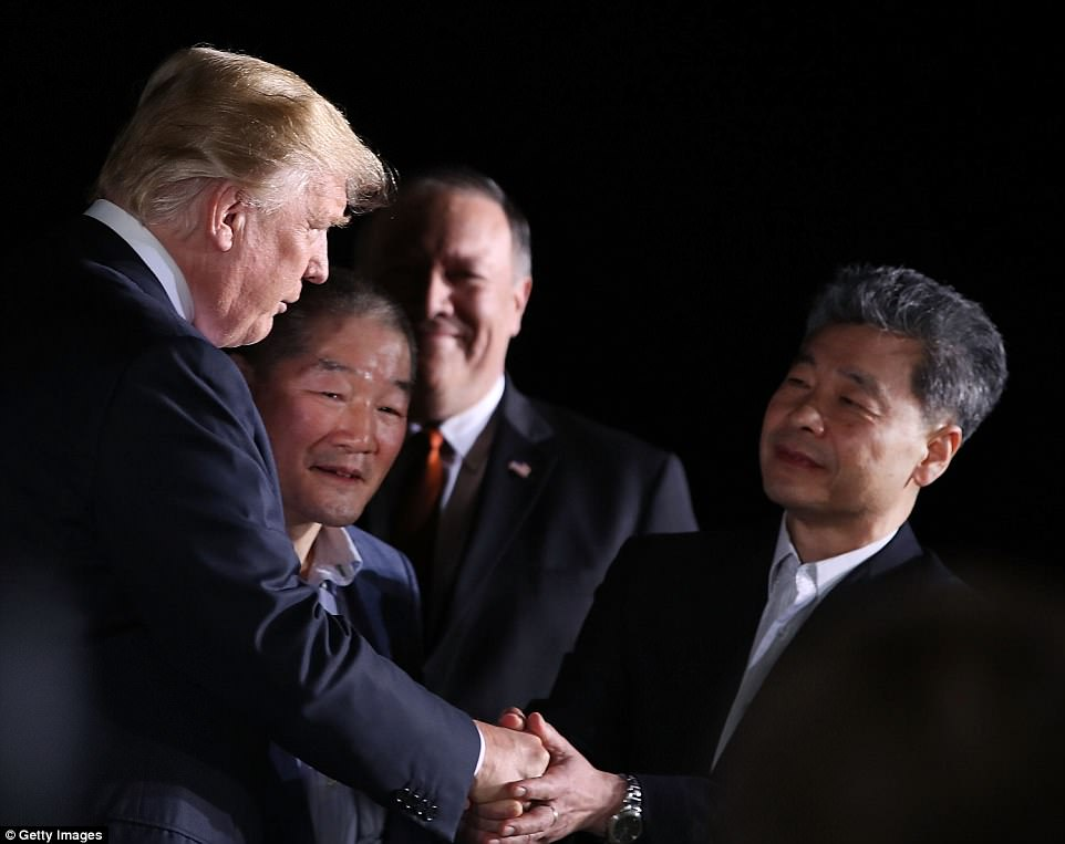President Donald Trump stands with Americans just released from North Korea, Kim Dong Chul, Kim Hak-song and Tony Kim, as Secretary of State Mike Pompeo stands nearby, at Joint Base Andrews early this morning
