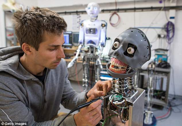 Engineered Arts electrical engineer Beni Szlivka works on the skeleton structure of a Mesmer robot that is being built at the company's headquarters in Penryn