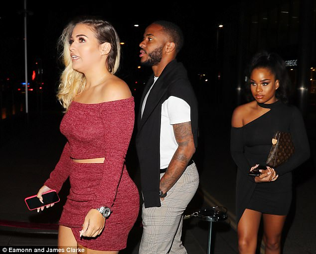 Raheem Sterling and fiance Paige Milian (right) looked relaxed as they made their way inside