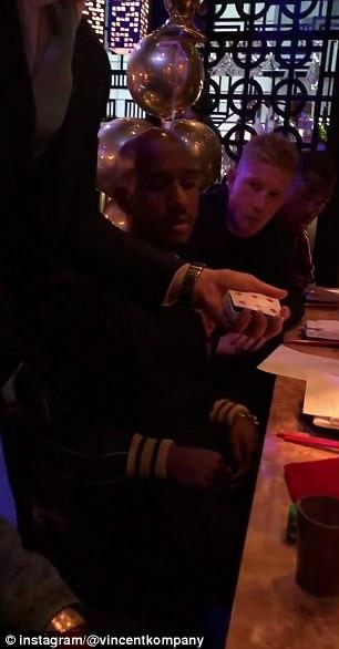 Fabian Delph (left) and De Bruyne enjoy the magician's tricks