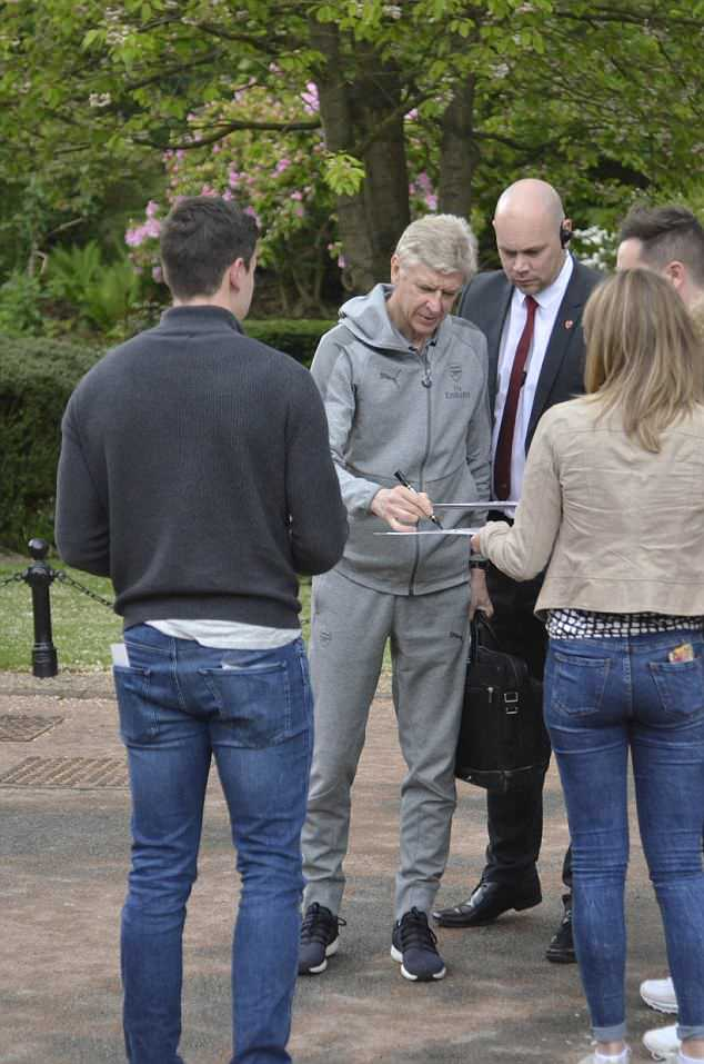 Arsene Wenger posed for pictures and signed autographs for fans at Oulton Hall hotel