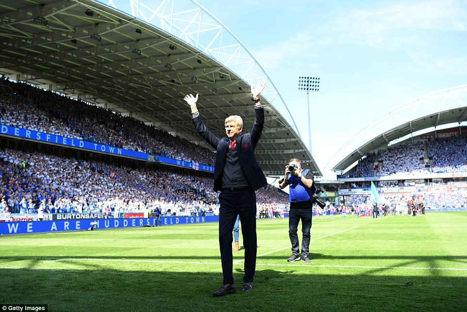 Arsene Wenger waves to the Arsenal fans as he ended his 22-year run at the club with a victory at Huddersfield