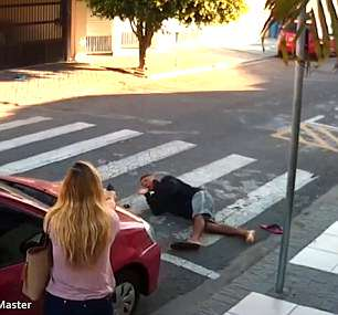 Officer Sastre orders the suspect to turn over and pushes him with her foot into a facedown position