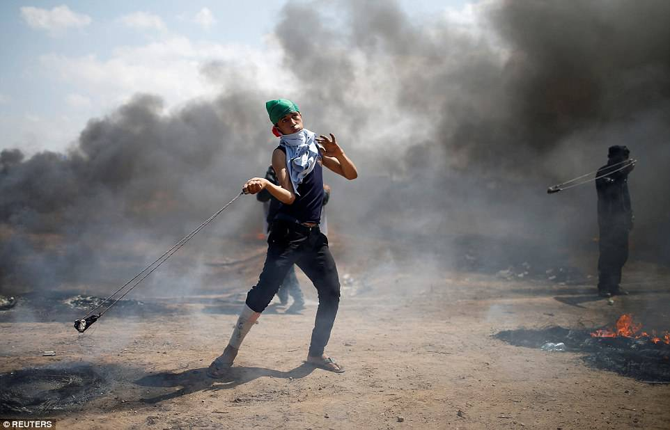 Thousands gathered in five spots along the border in protest at the embassy move, while sporadic clashes also erupted with Israeli soldiers
