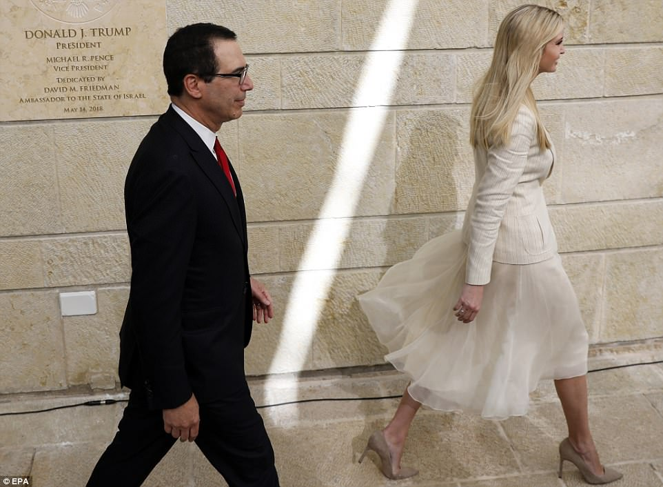 As deadly clashes continued this afternoon, Trump said in a video address aired at the opening that the embassy in has been a 'long time coming'. His daughter Ivanka as pictured walking ahead of US Treasury Secretary Steven Mnuchin at the ceremony today