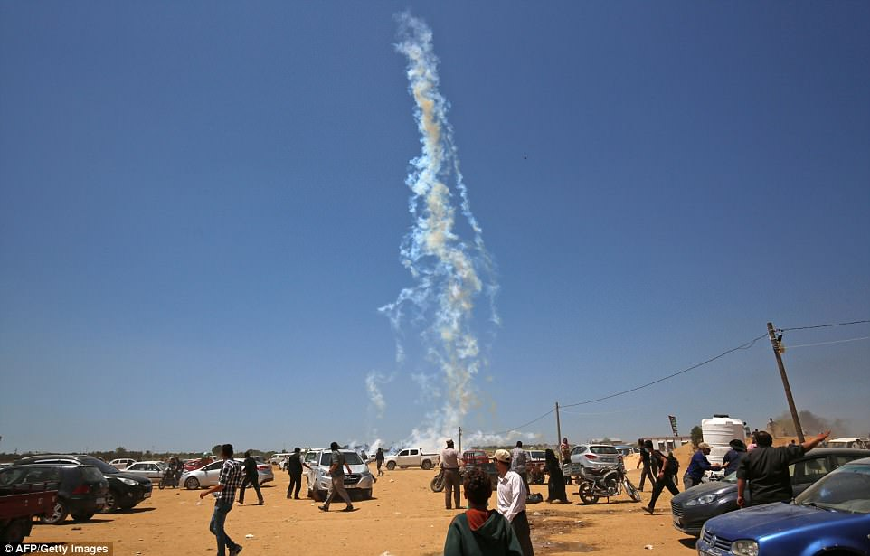 Palestinians were forced to run for safety as the gas canisters containing tear gas were fired from drones overhead today