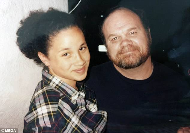 Daddy's girl: Meghan is pictured with her father, Thomas Markle Snr., now 73, when she was just 13 years old