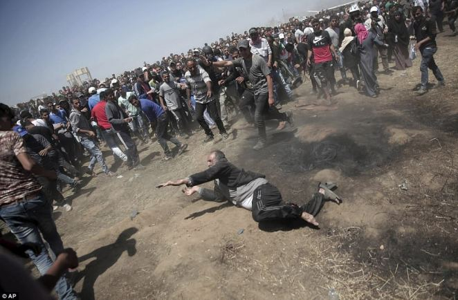 Tens of thousands of Palestinians rallied near the border fence, with smaller numbers seeking to breach it. Israeli forces on the border used tear gas and sniper fire on the crowds