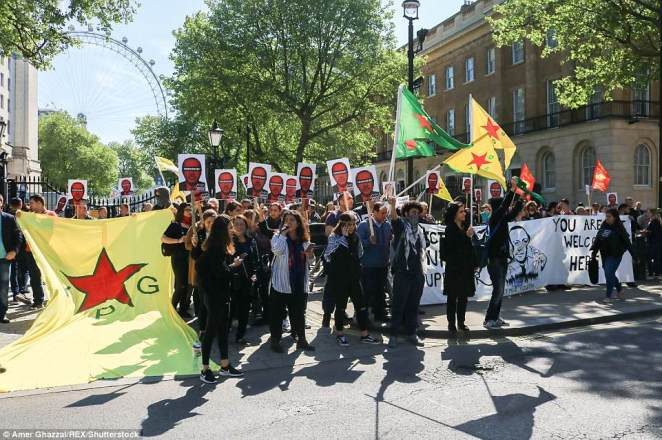 Many dozens of protesters gathered in Whitehall today (pictured) to vent their fury at the Turkish leader's visit