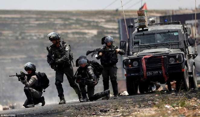 Israeli border police take up positions during clashesBeit El, near Ramallah, West Bank. Violent scenes unfolded during a Palestinian protest marking the 70th anniversary of Nakba
