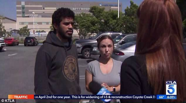 The twins' parents, Jeremiah Edwards and Erika Alvarado, are pictured above outside the hospital where one of their daughters continues to recover