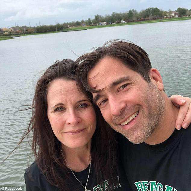 The family, aside from Stone, had taken a paddleboarding trip together and were returning to Paul Garcia's home when the shooting began. John Micheal Garcia is pictured with his wife Lisa