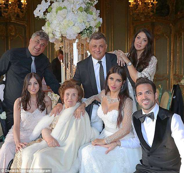 Fabregas (bottom right) poses with wife and her family in the reception afterwards
