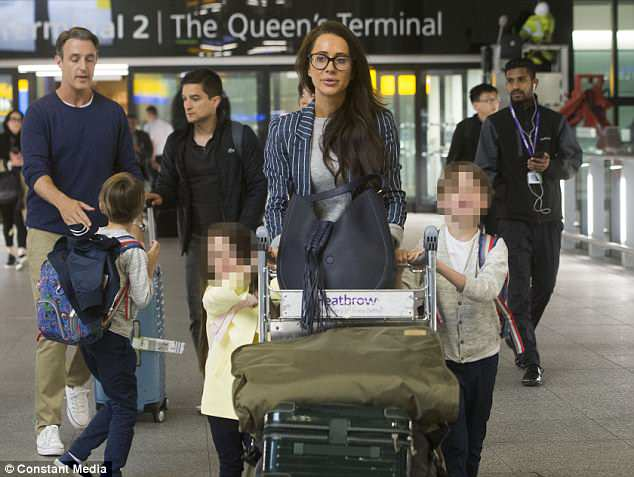 Meghan Markle's best friend Jessica Mulroney arrives at London Heathrow Airport this morning with her husband Ben Mulroney and their three children