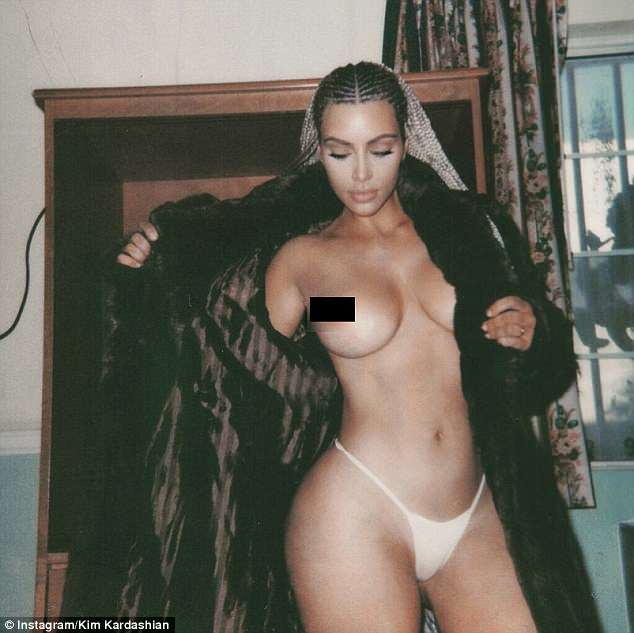 Stripping off: It is not the first time Kim has faced backlash for her online activity - having come under fire for sharing a string of nearly naked snaps in February