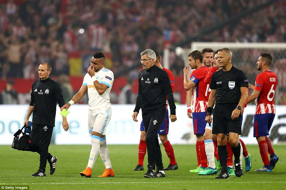 Things went from bad to worse for Marseille when Dimitri Payet (second left) was forced off after 30 minutes with an injury