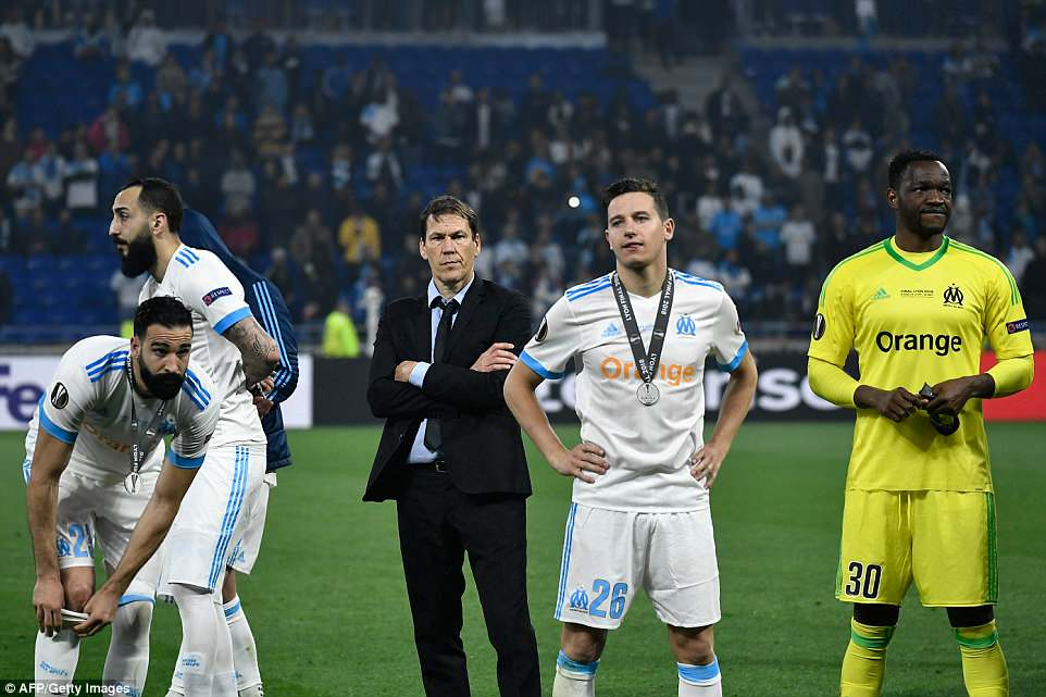 Marseille manager Rudi Garcia (centre) watches on with his players as Atletico Madrid go up to receive their trophy