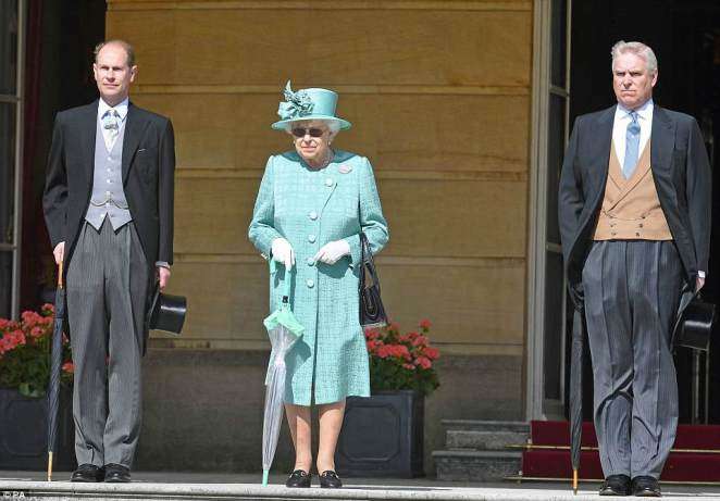 At 1pm, the congregation will file out of the chapel to see the newlyweds leave before heading to St George¿s Hall for the lunchtime reception hosted by the Queen. Her Majesty is pictured with the Earl of Wessex and the Duke of York at a garden party on Tuesday at Buckingham Palace