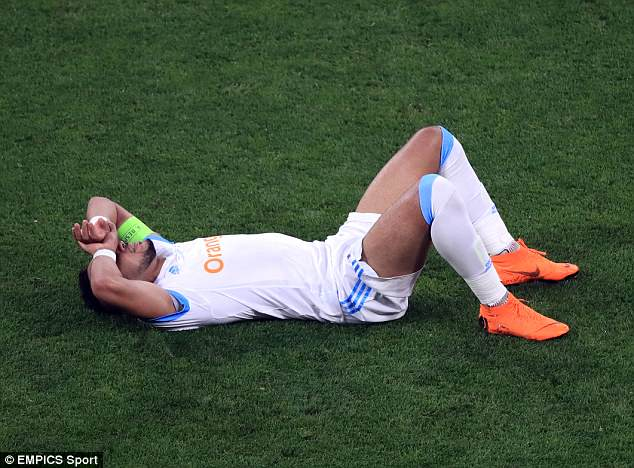 Payet lies in tears on the pitch as he realises his evening in the Europa League final is over