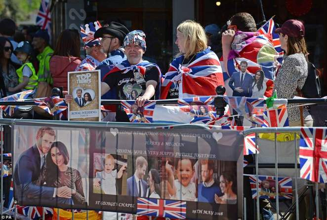 Royal fans wait to watch members of the armed forces in a parade rehearsal in Windsor, Berkshire ahead of the wedding of Prince Harry and Meghan Markle